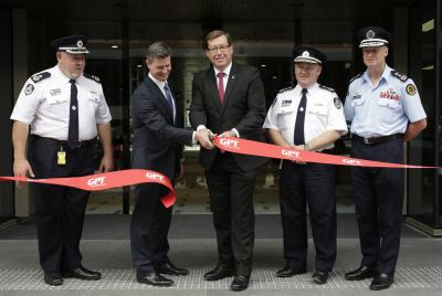 Minister for Emergency Services, Troy Grant, cuts the ribbon alongside Jamie Nelson (GPT) Commissioner Shane Fitzsimmons and Commissioner Mark Smethurst.